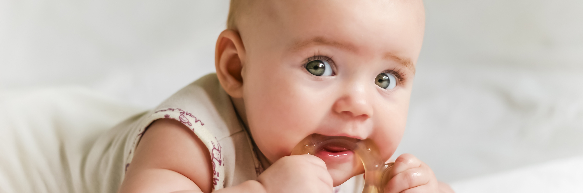 Baby biting on teething ring